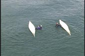 two capsized kayakers