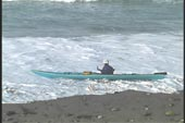 Kayak now parallel to ocean due to surge water